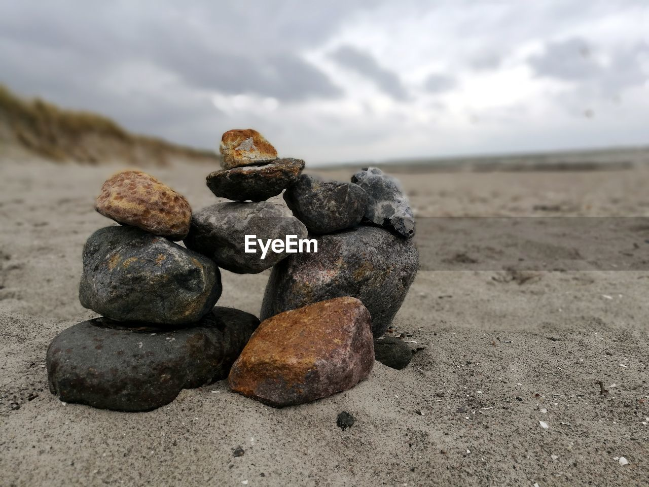 rock - object, beach, sand, stack, pebble, no people, sky, cloud - sky, nature, day, outdoors, sea, beauty in nature, close-up