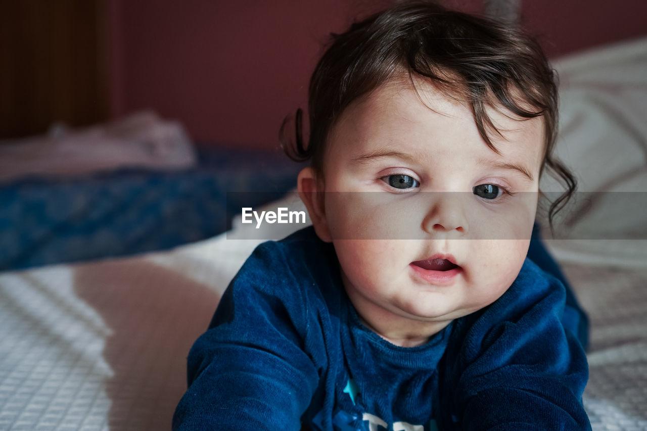 Close-up of cute baby at home