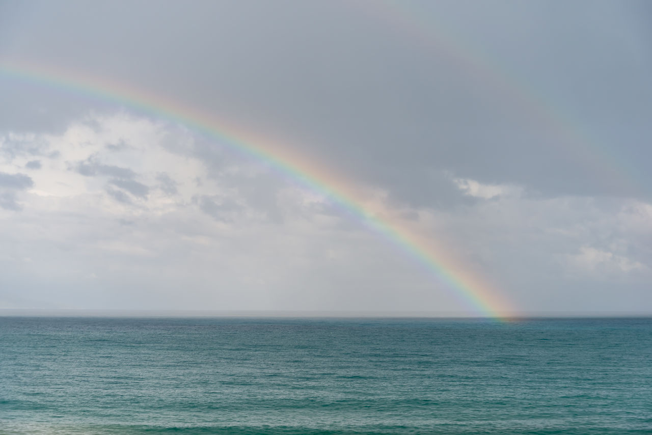 rainbow, beauty in nature, water, sea, scenics - nature, multi colored, horizon over water, sky, horizon, cloud - sky, nature, idyllic, double rainbow, tranquility, waterfront, no people, tranquil scene, natural phenomenon, outdoors