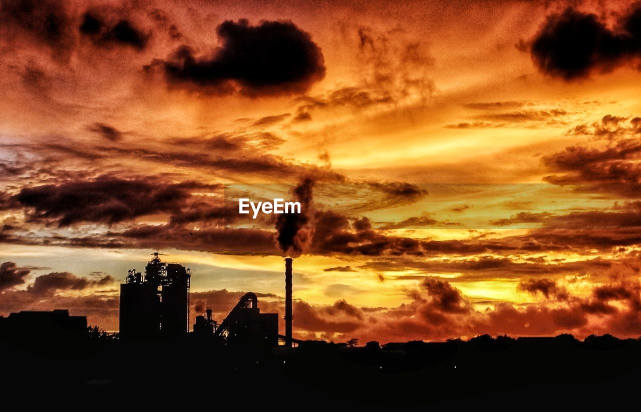 sky, sunset, cloud - sky, architecture, building exterior, built structure, silhouette, orange color, building, nature, no people, tower, beauty in nature, outdoors, industry, scenics - nature, factory, tall - high, city, sunlight, skyscraper