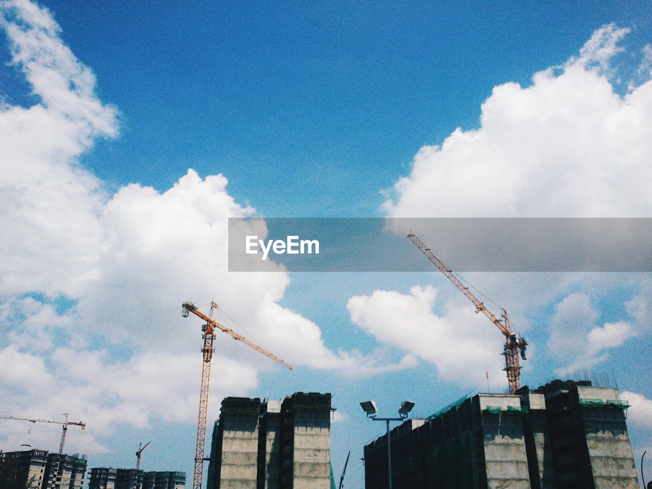 architecture, built structure, building exterior, construction, sky, cloud - sky, low angle view, construction site, crane, day, outdoors, industry, no people, city, factory