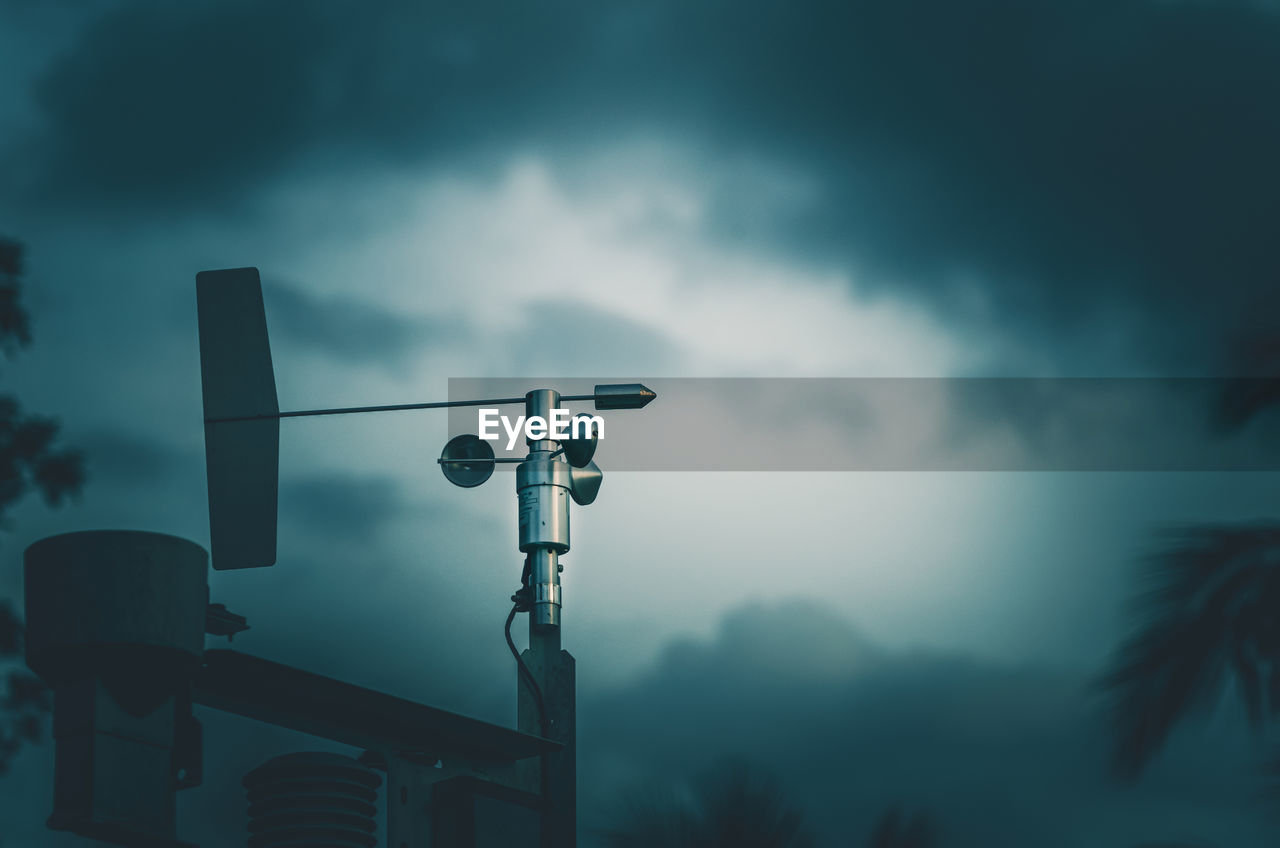 Cup anemometer is instrument used to measure wind speed and blue sky background.