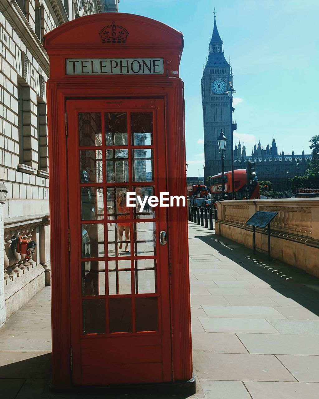architecture, building exterior, built structure, text, travel destinations, telephone booth, day, red, clock tower, city, communication, outdoors, pay phone, no people, sky