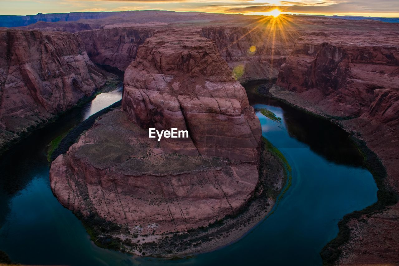 Scenic view of horseshoe bend during sunset