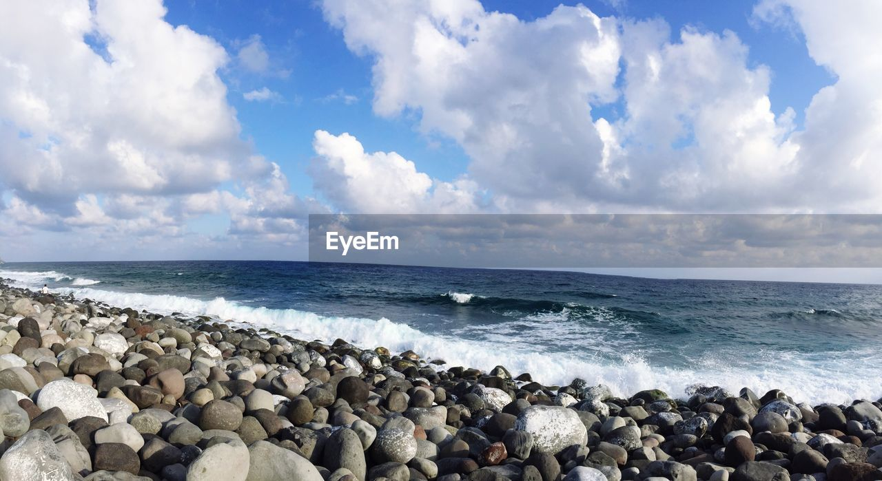 sea, water, sky, cloud - sky, horizon, horizon over water, beach, scenics - nature, beauty in nature, land, rock, day, nature, solid, tranquil scene, tranquility, wave, motion, idyllic, no people, pebble, outdoors