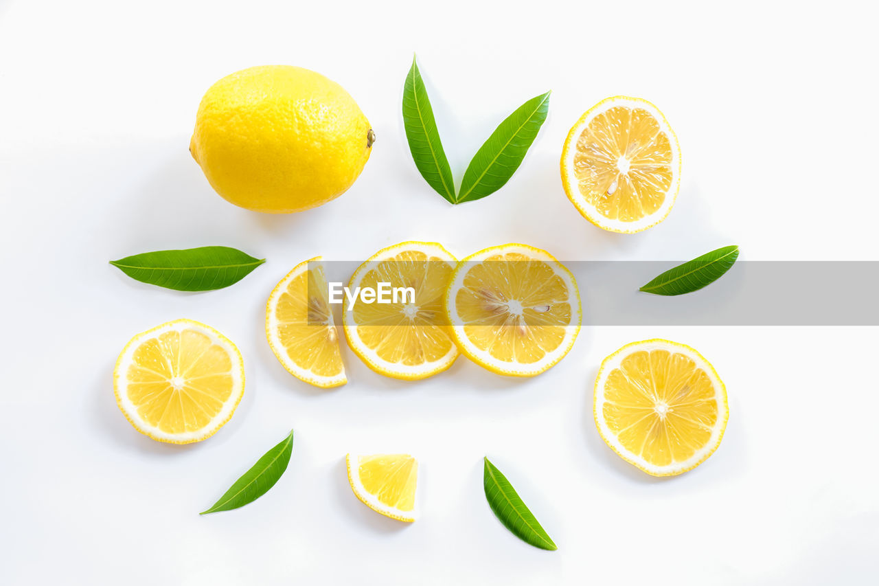 ORANGE FRUITS ON WHITE