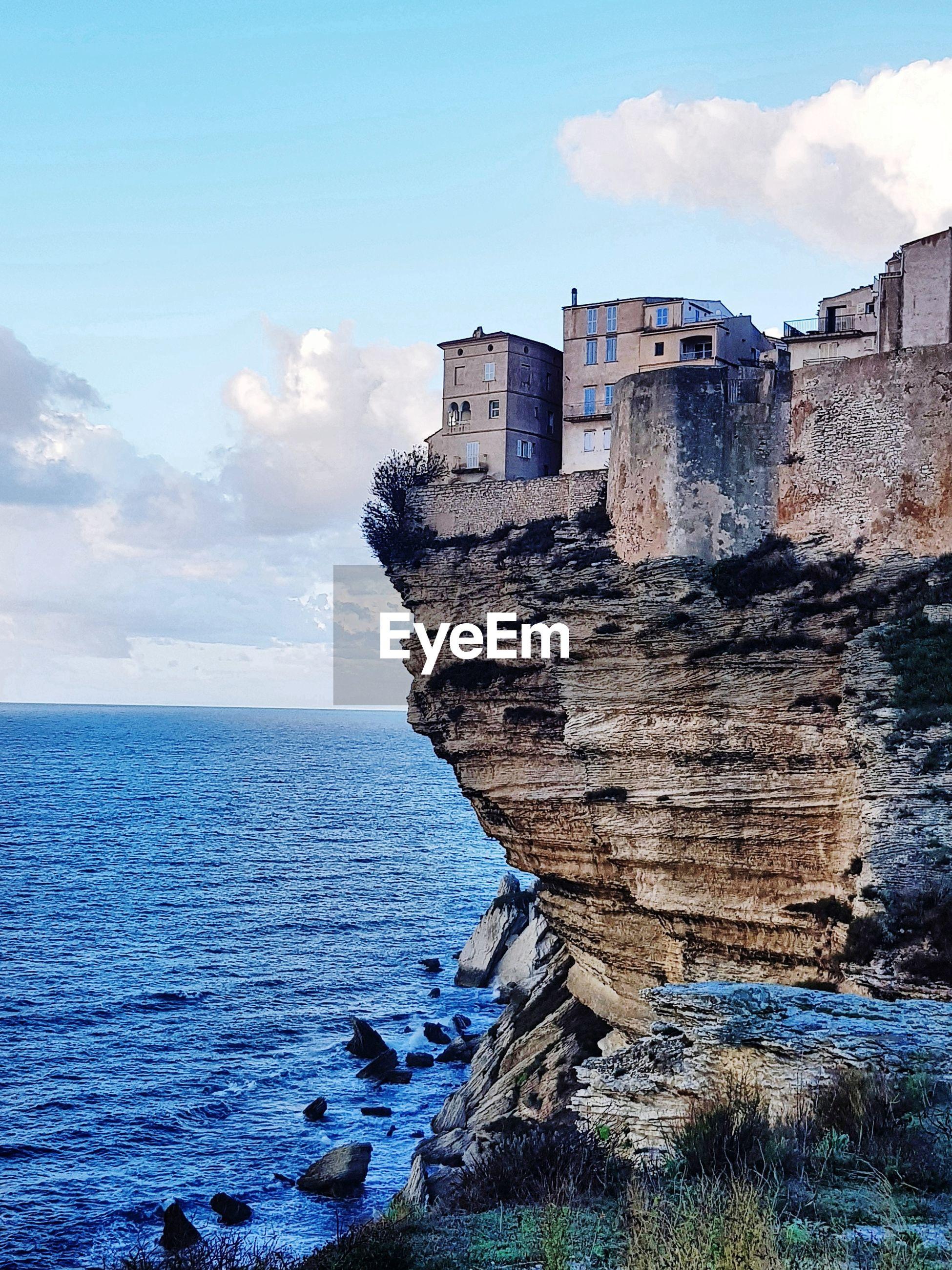 SEA SHORE AGAINST BUILDINGS