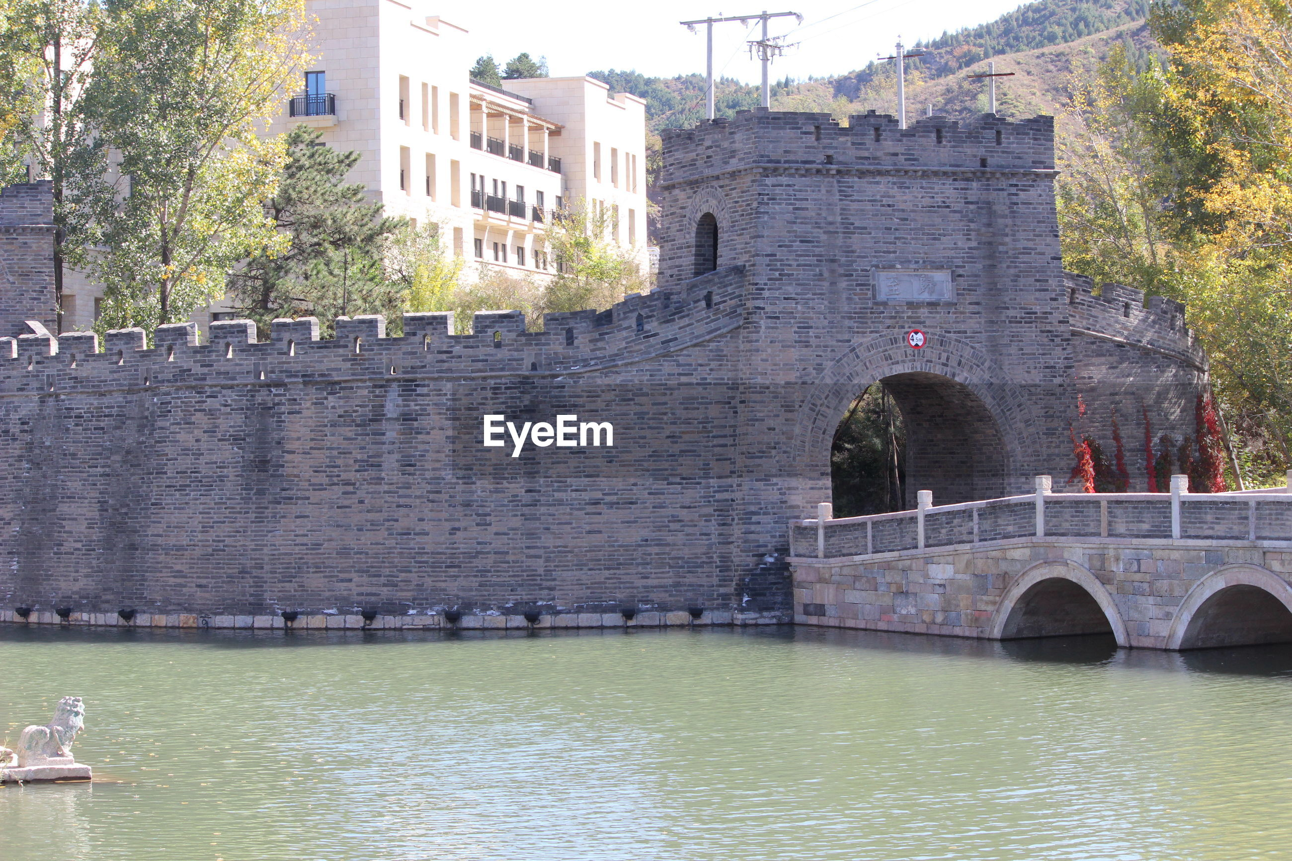 ARCH BRIDGE OVER RIVER BY BUILDINGS