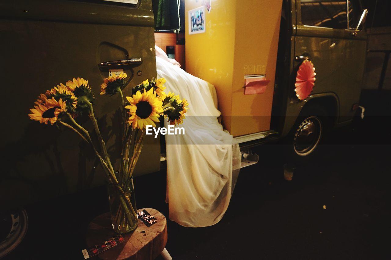 YELLOW FLOWER IN CAR