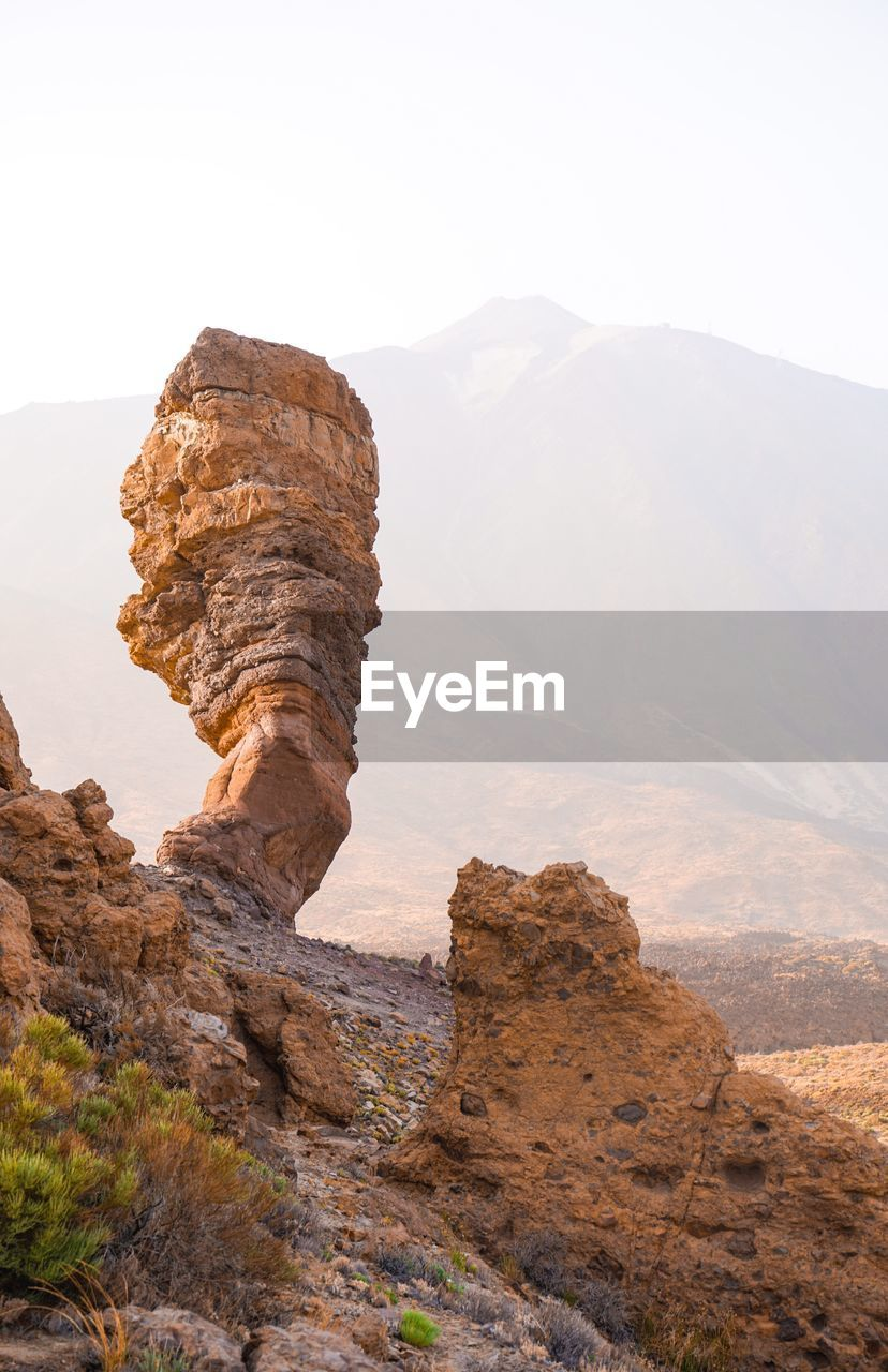 rock, rock - object, tranquil scene, scenics - nature, tranquility, mountain, rock formation, solid, non-urban scene, beauty in nature, physical geography, sky, geology, environment, remote, landscape, nature, mountain range, no people, day, formation, eroded, climate, outdoors, arid climate, mountain peak