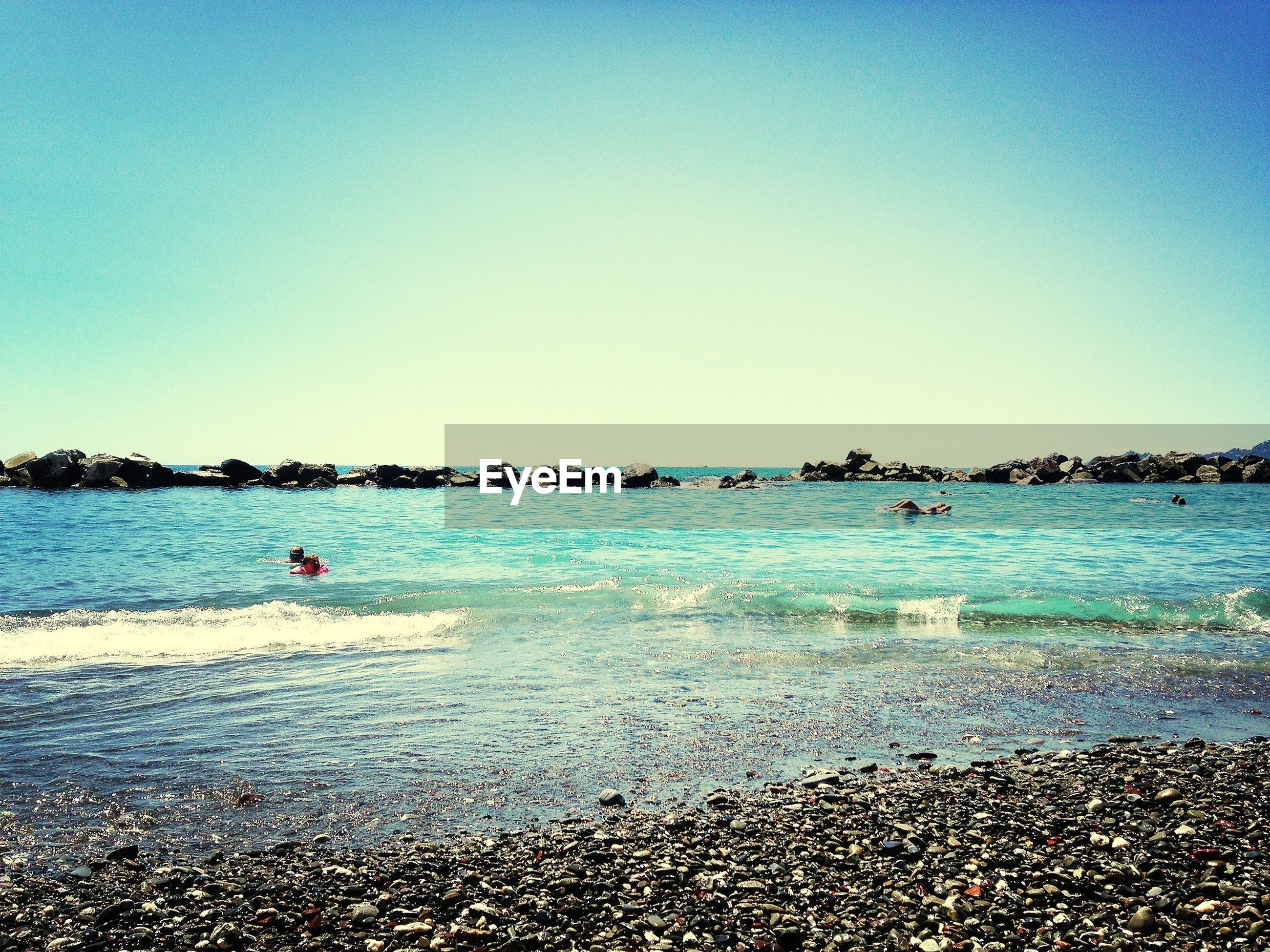 beach, water, sea, clear sky, shore, copy space, sand, blue, scenics, tranquil scene, tranquility, beauty in nature, vacations, nature, horizon over water, coastline, leisure activity, incidental people, large group of people