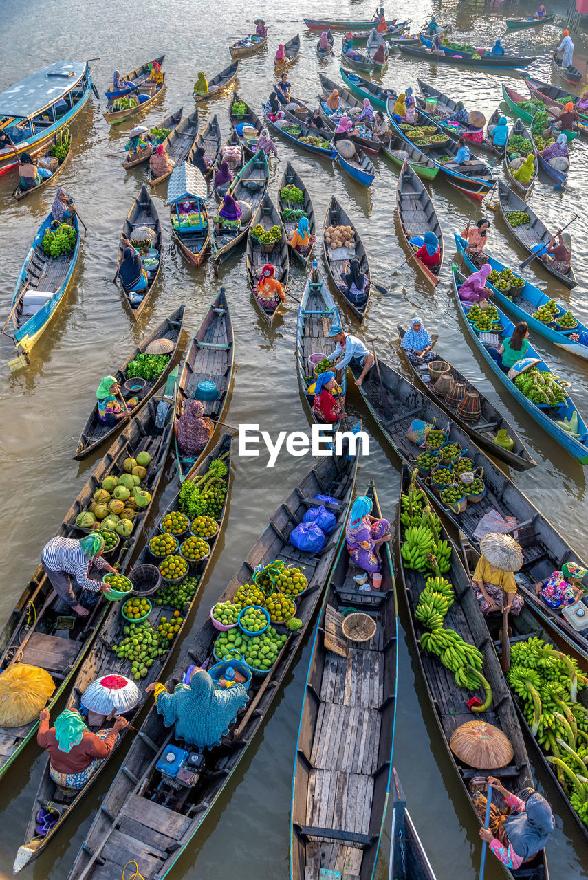 High angle view of floating market on river