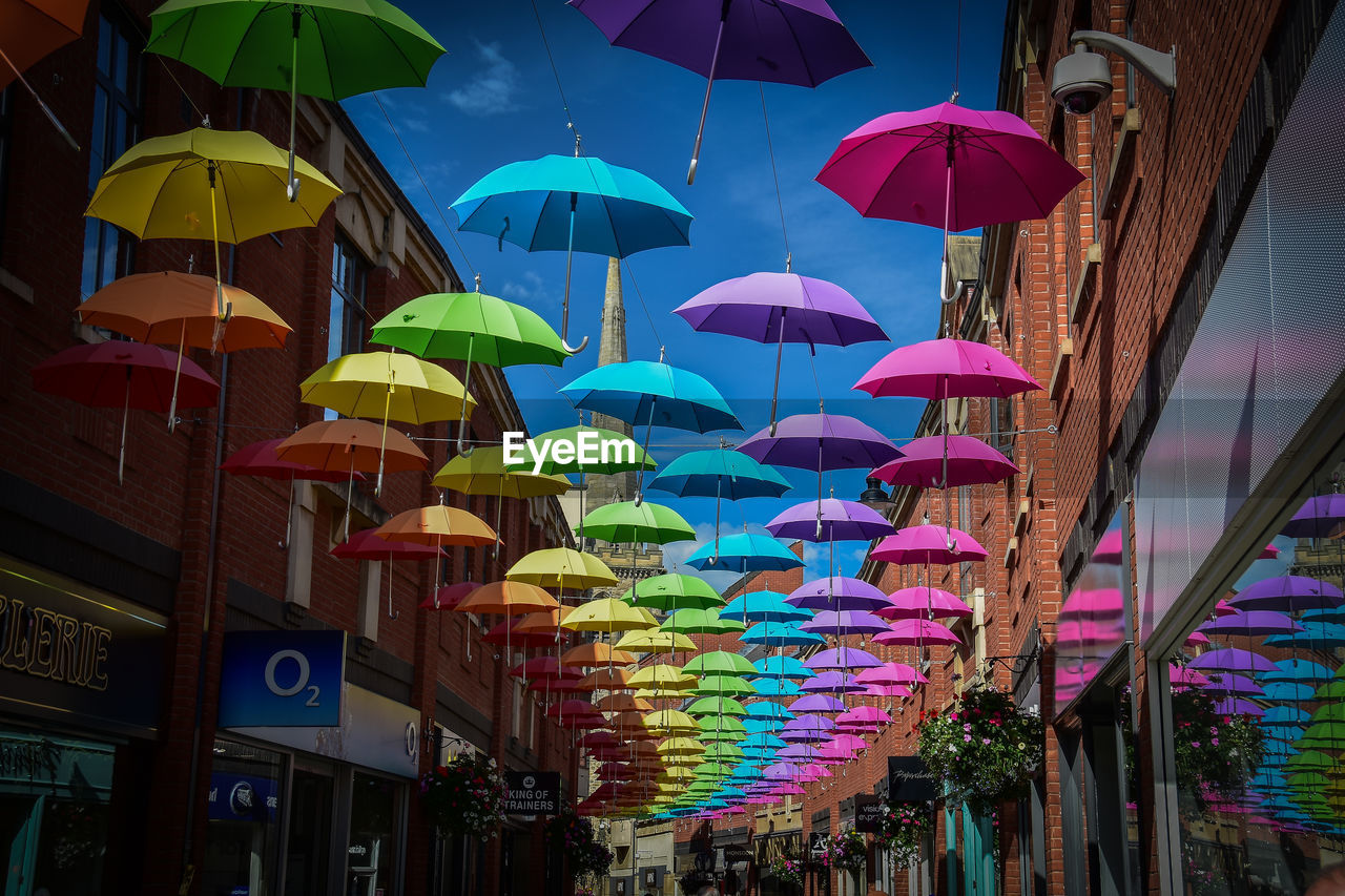multi colored, architecture, built structure, building exterior, city, umbrella, hanging, protection, outdoors, nature, retail, day, no people, low angle view, large group of objects, market, choice, decoration