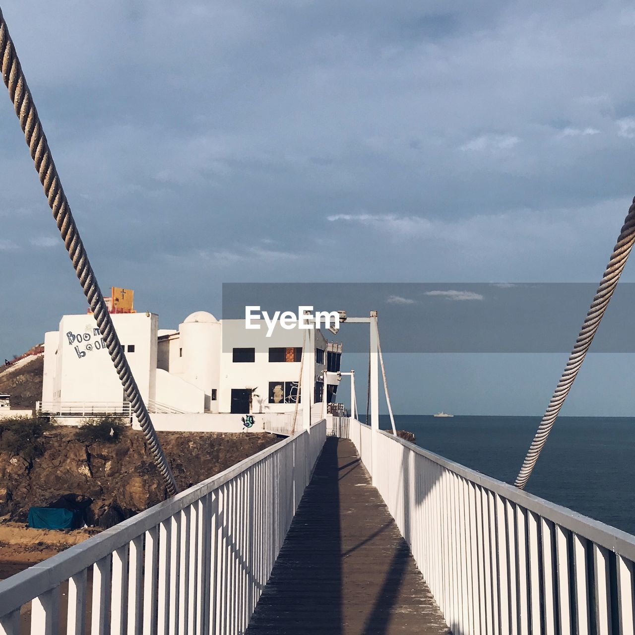 architecture, built structure, sky, water, cloud - sky, railing, nature, sea, building exterior, day, no people, the way forward, sunlight, direction, outdoors, connection, building, horizon over water, bridge