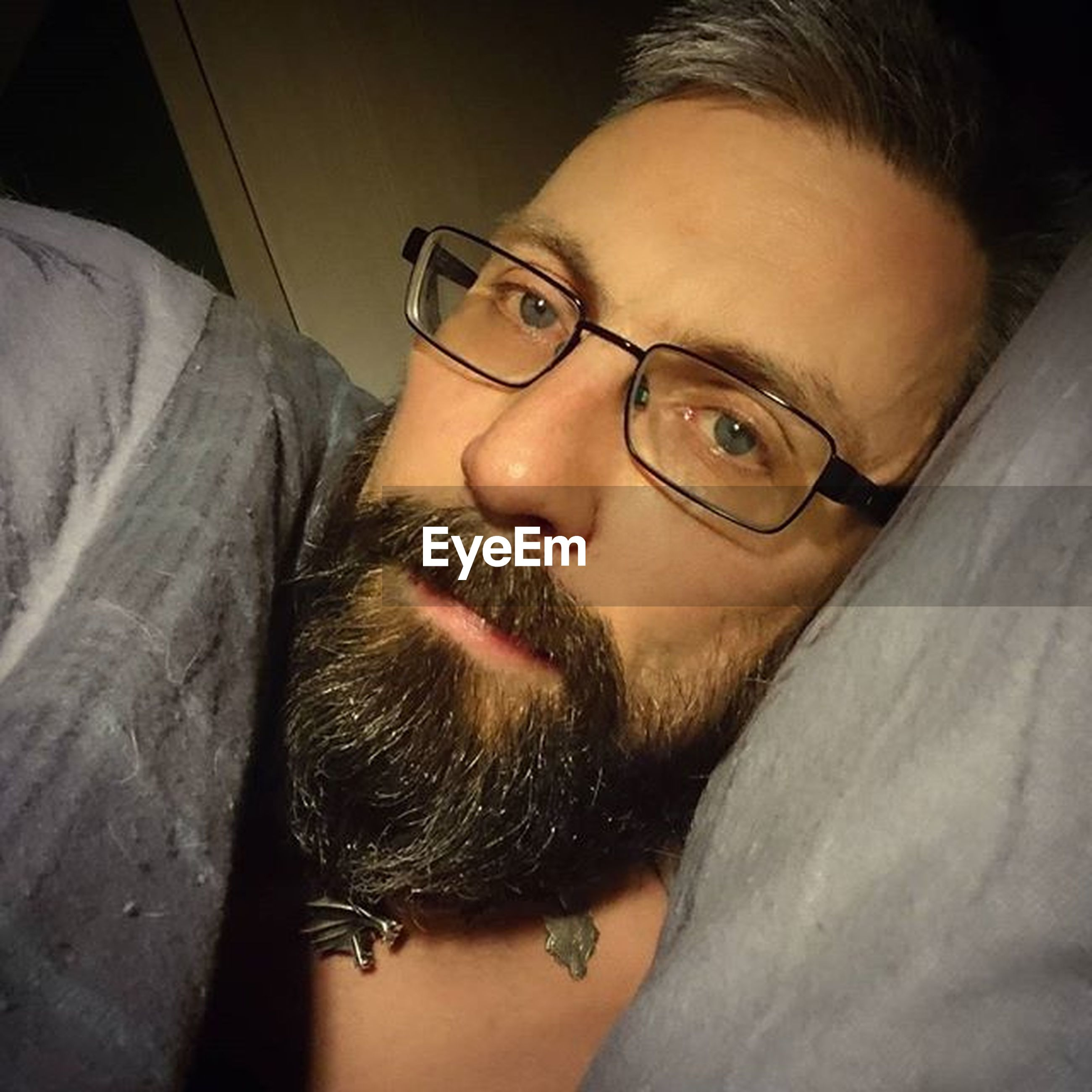 looking at camera, portrait, indoors, headshot, young adult, lifestyles, sunglasses, leisure activity, person, front view, close-up, young men, beard, eyeglasses, mid adult, mid adult men, human face, men