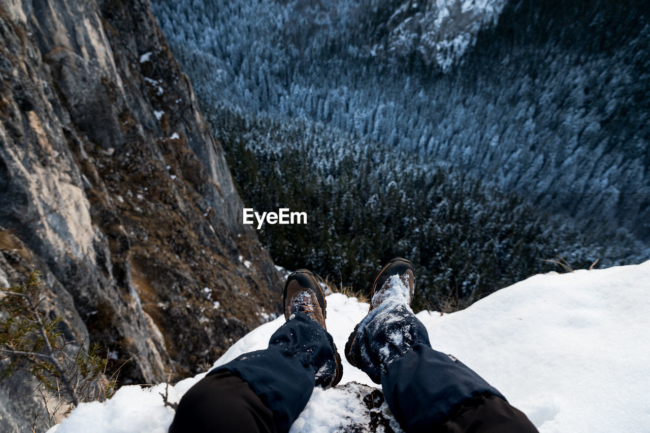 Low section of person on snowcapped mountain