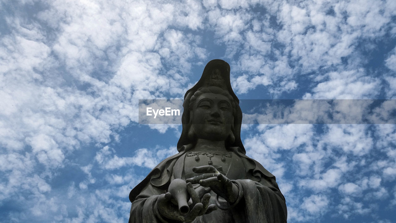 statue, cloud - sky, sculpture, low angle view, sky, art and craft, human representation, day, no people, outdoors, blue