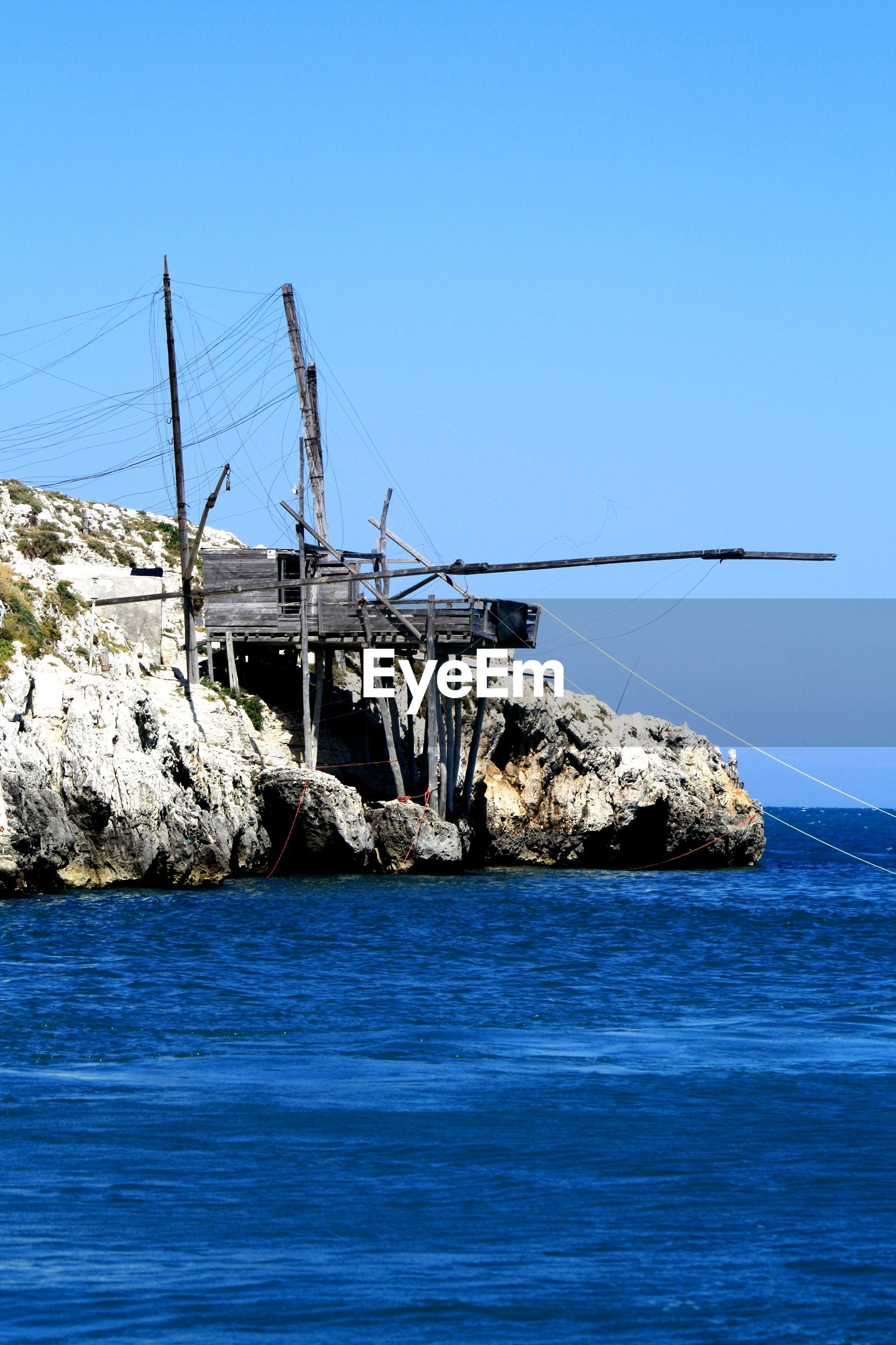 VIEW OF SAILBOAT IN SEA AGAINST CLEAR BLUE SKY
