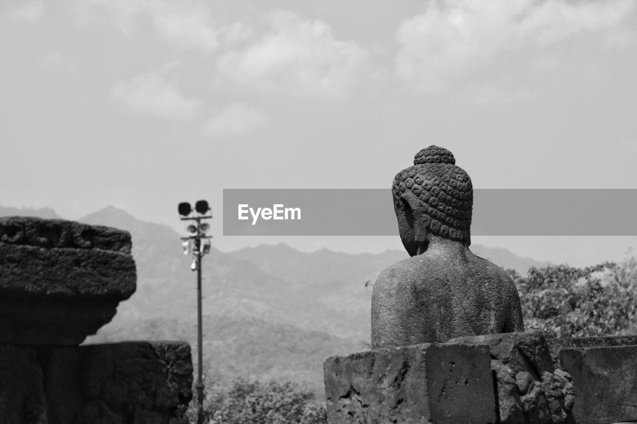 Buddha Sculpture At Borobudur Temple Against Sky