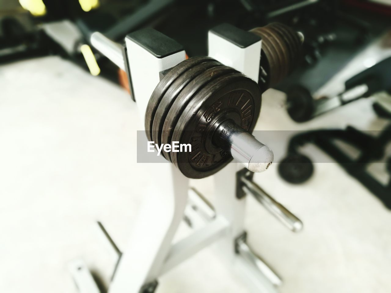 High Angle View Of Dumbbells In Gym