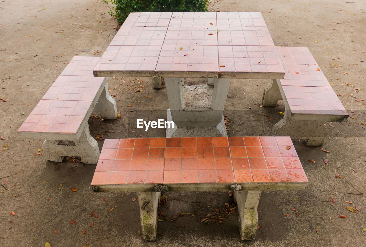 high angle view, bench, seat, day, no people, outdoors, table, wood - material, nature, empty, absence, rusty, park, old, park - man made space, field, footpath, plant, damaged