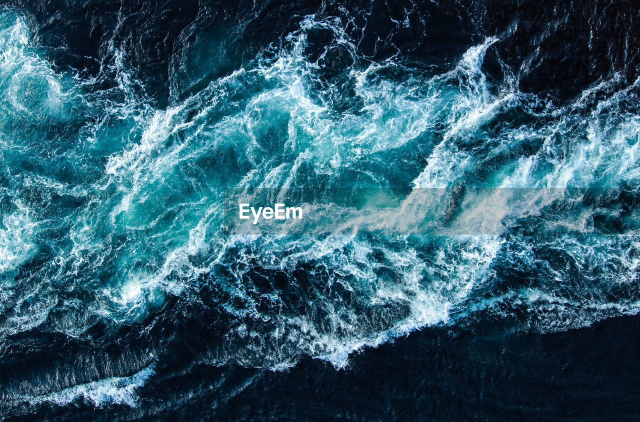 sea, water, motion, wave, beauty in nature, nature, surfing, sport, aquatic sport, power, power in nature, day, outdoors, rock, splashing, scenics - nature, waterfront, rock - object, breaking, turquoise colored