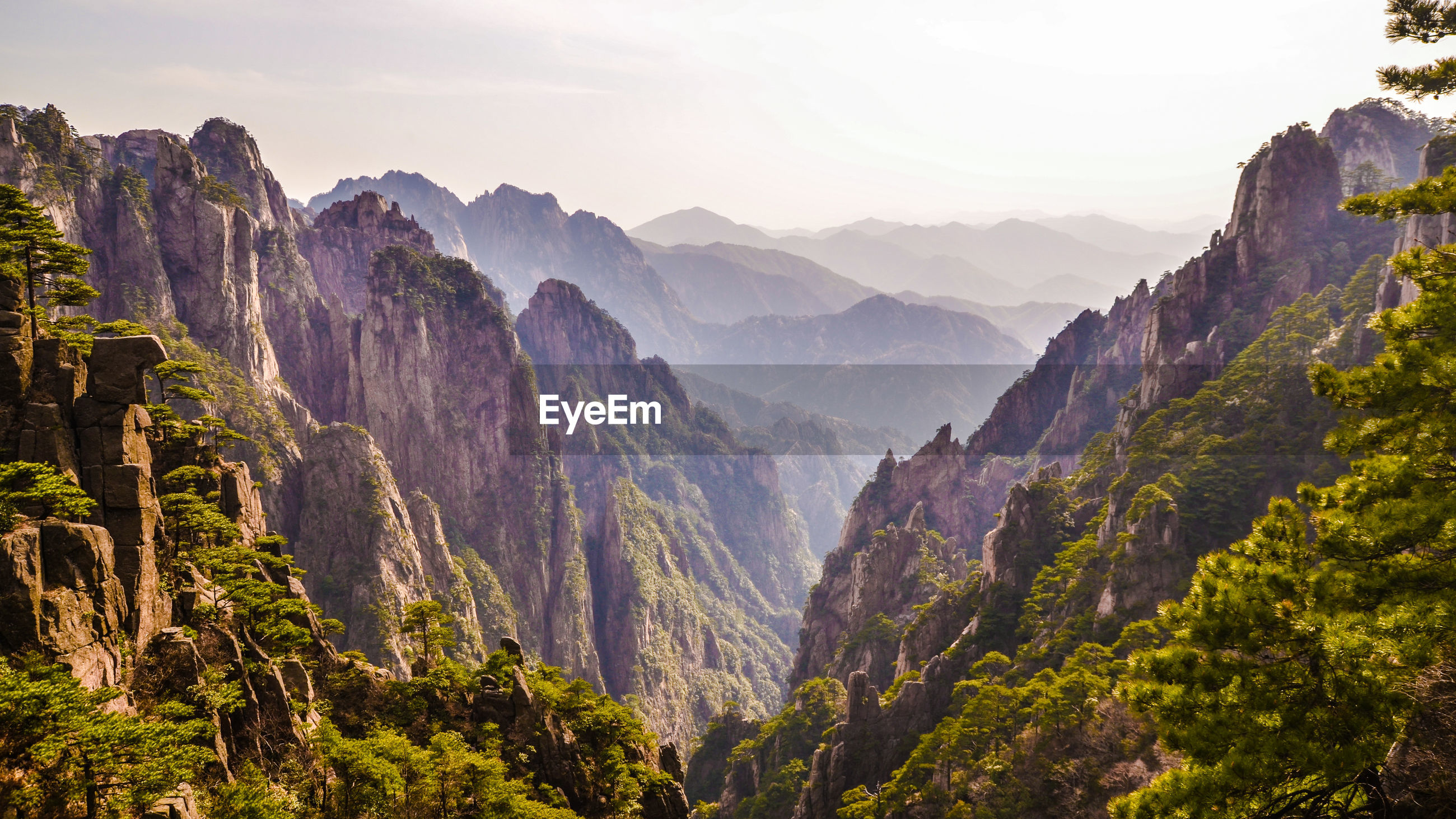 Scenic view of mountain ranges against sky