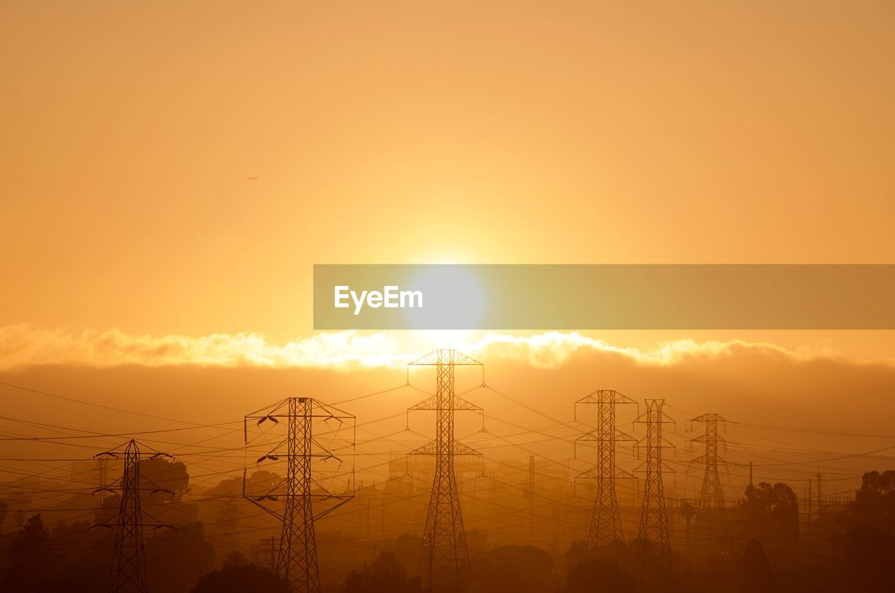 sky, sunset, electricity, technology, orange color, electricity pylon, silhouette, power line, sun, cable, power supply, connection, fuel and power generation, beauty in nature, cloud - sky, nature, scenics - nature, outdoors, no people, sunlight, bright, electrical equipment, brightly lit