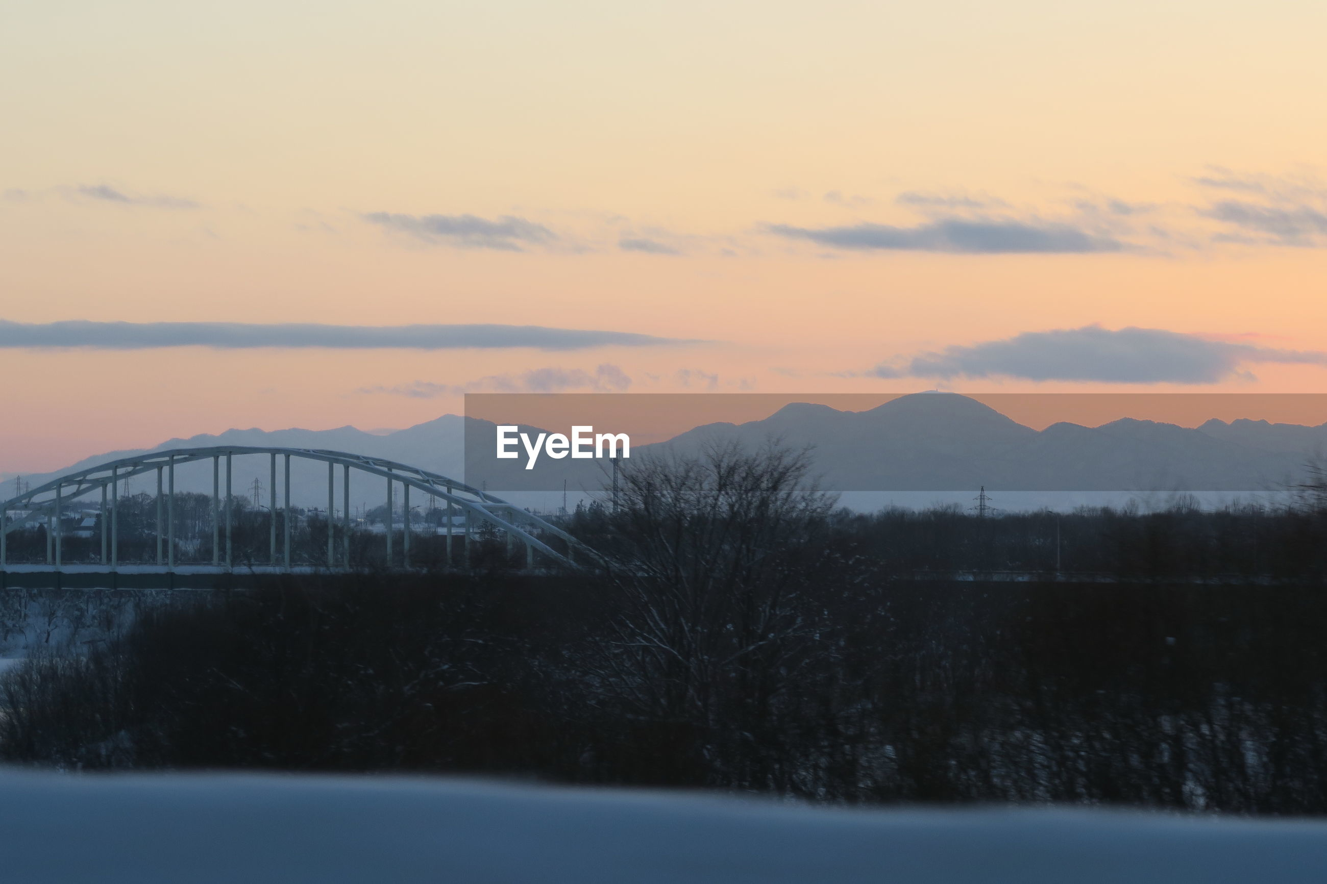 SCENIC VIEW OF SILHOUETTE BRIDGE AGAINST SKY DURING SUNSET