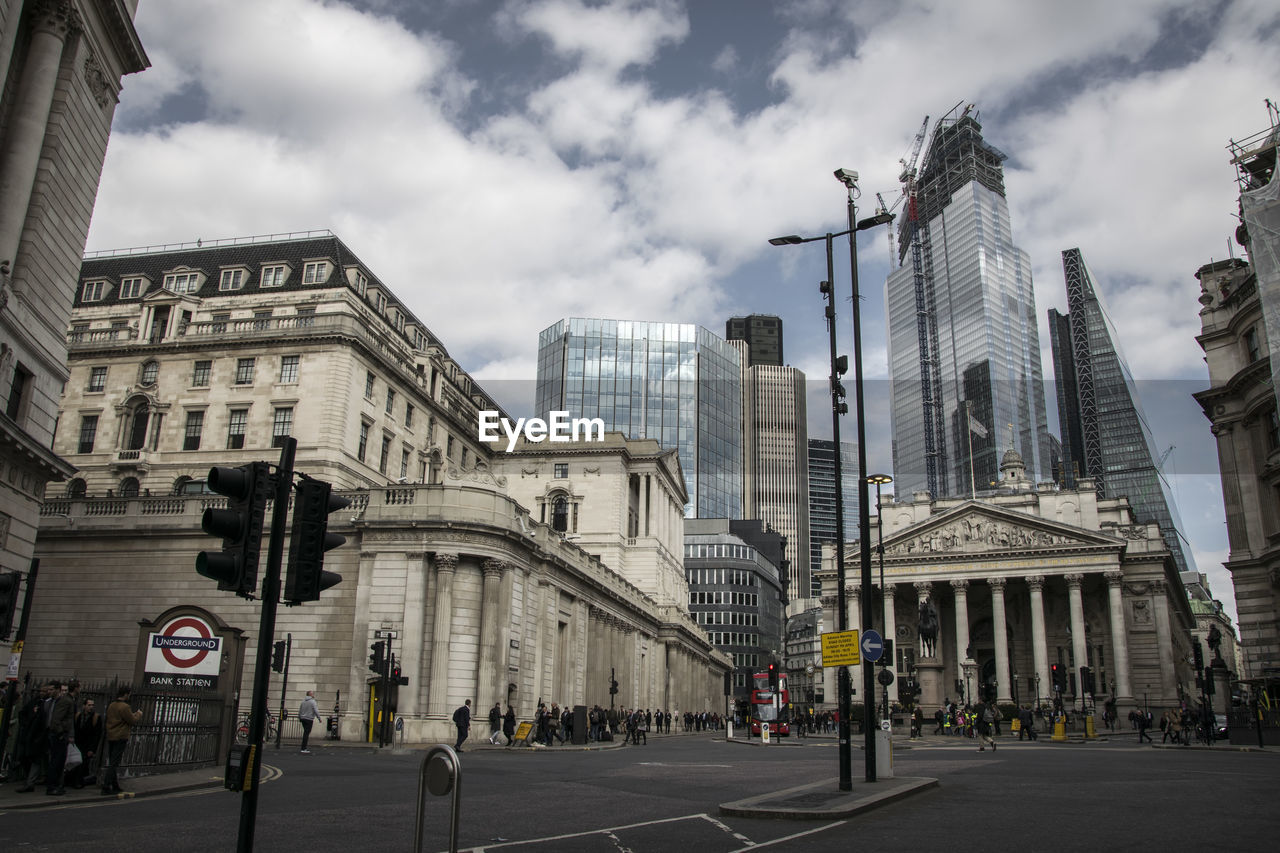 building exterior, architecture, built structure, city, sky, cloud - sky, street, building, transportation, road, city life, office building exterior, sign, incidental people, day, group of people, nature, skyscraper, city street