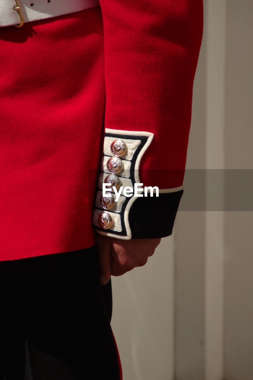 Midsection of british royal guard in uniform
