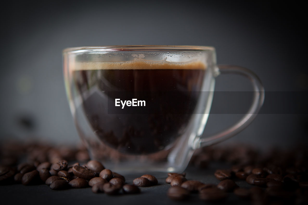 food and drink, drink, coffee, coffee - drink, cup, refreshment, roasted coffee bean, still life, freshness, mug, indoors, close-up, food, table, no people, transparent, coffee cup, selective focus, glass - material, brown, glass, caffeine, non-alcoholic beverage, crockery