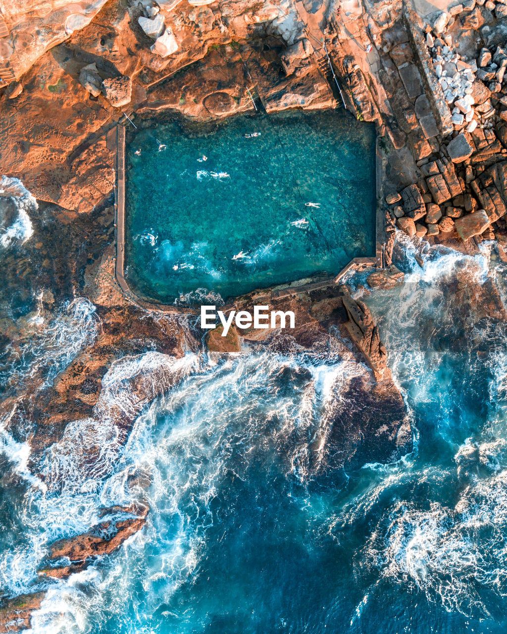 Aerial view of swimming pool in rock formation