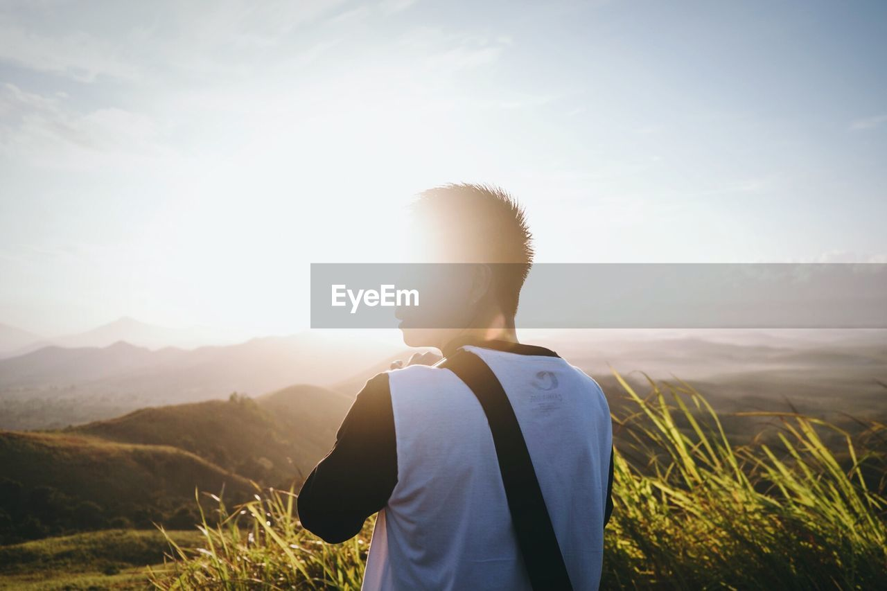 Man looking at mountain landscape