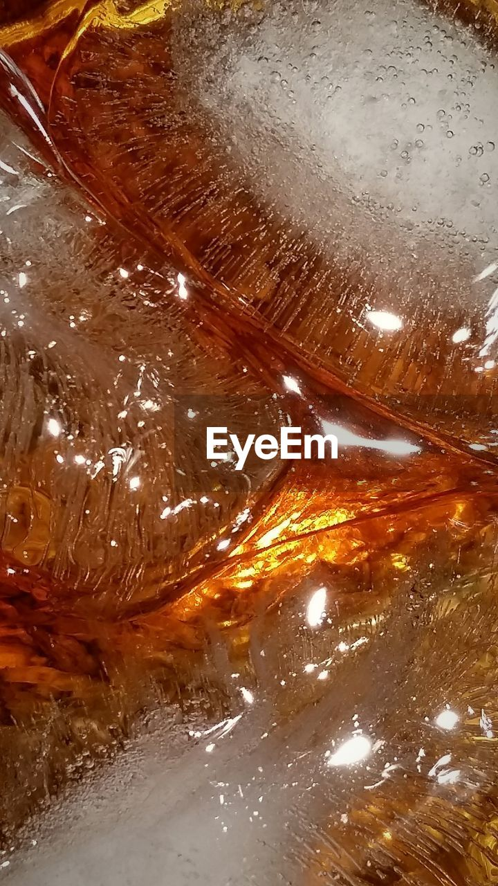 Close-up of ice in alcohol