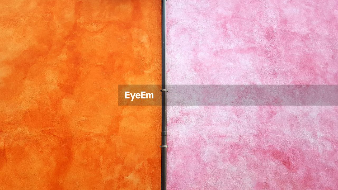 pink color, no people, full frame, backgrounds, close-up, indoors, textured, built structure, orange color, still life, red, pattern, multi colored, art and craft, architecture, wall - building feature, high angle view, paint, textile, day