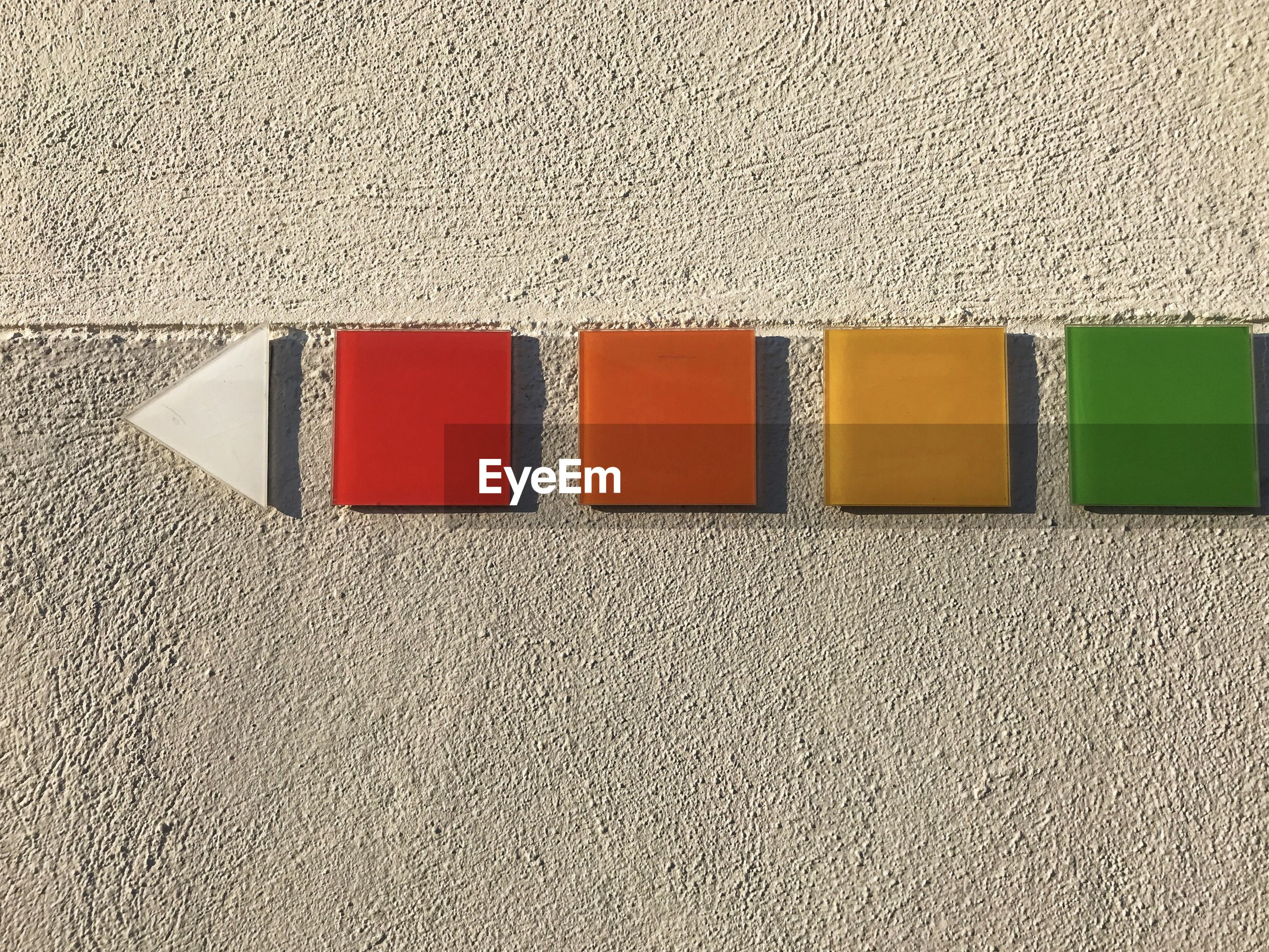 HIGH ANGLE VIEW OF MULTI COLORED WALL IN ROW