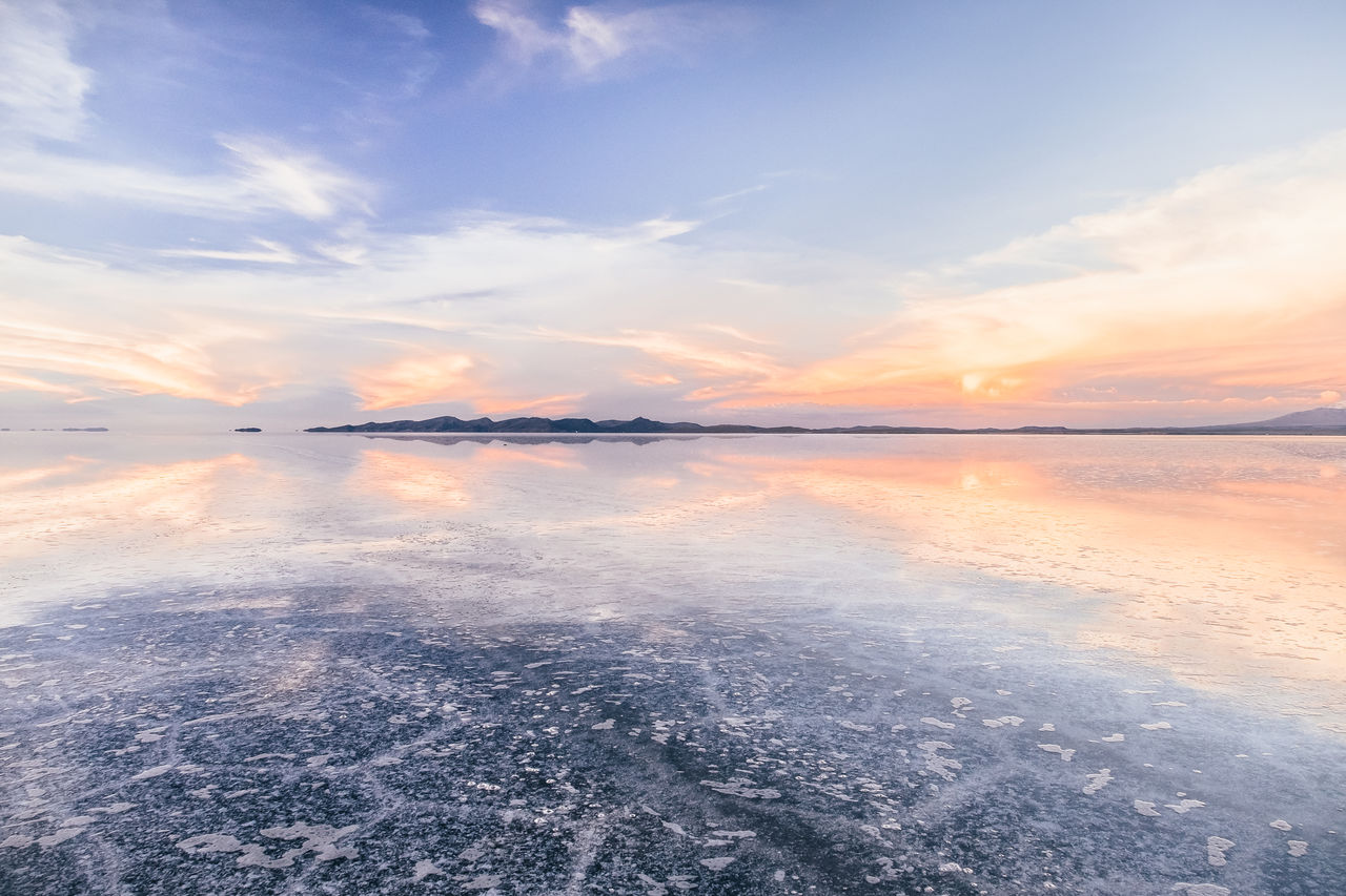 Scenic View Of Salt Flat Against Sky During Sunset