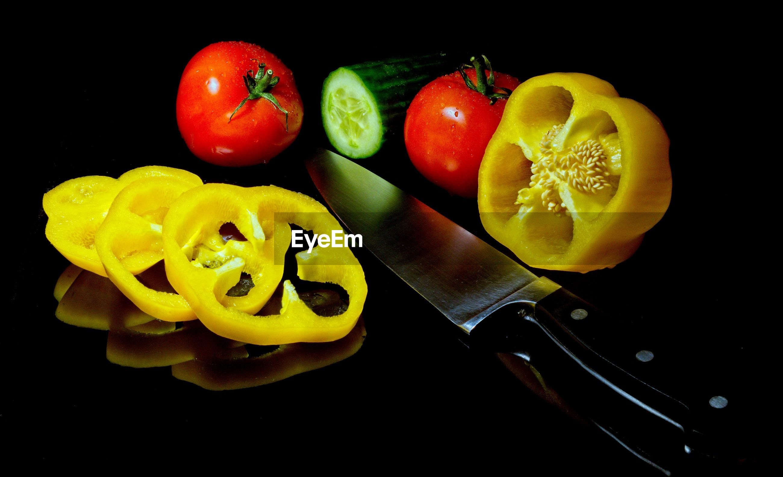 HIGH ANGLE VIEW OF CHOPPED FRUITS IN BLACK BACKGROUND