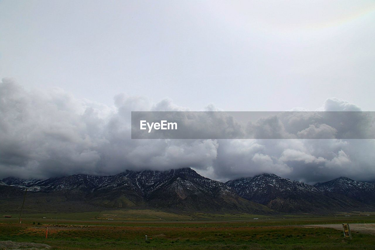 Scenic View Of Clouds Over Mountains