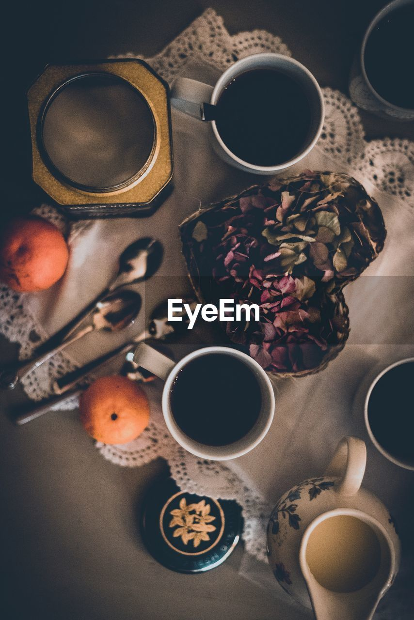 Directly Above Shot Of Black Coffees With Fruits And Vegetables On Table
