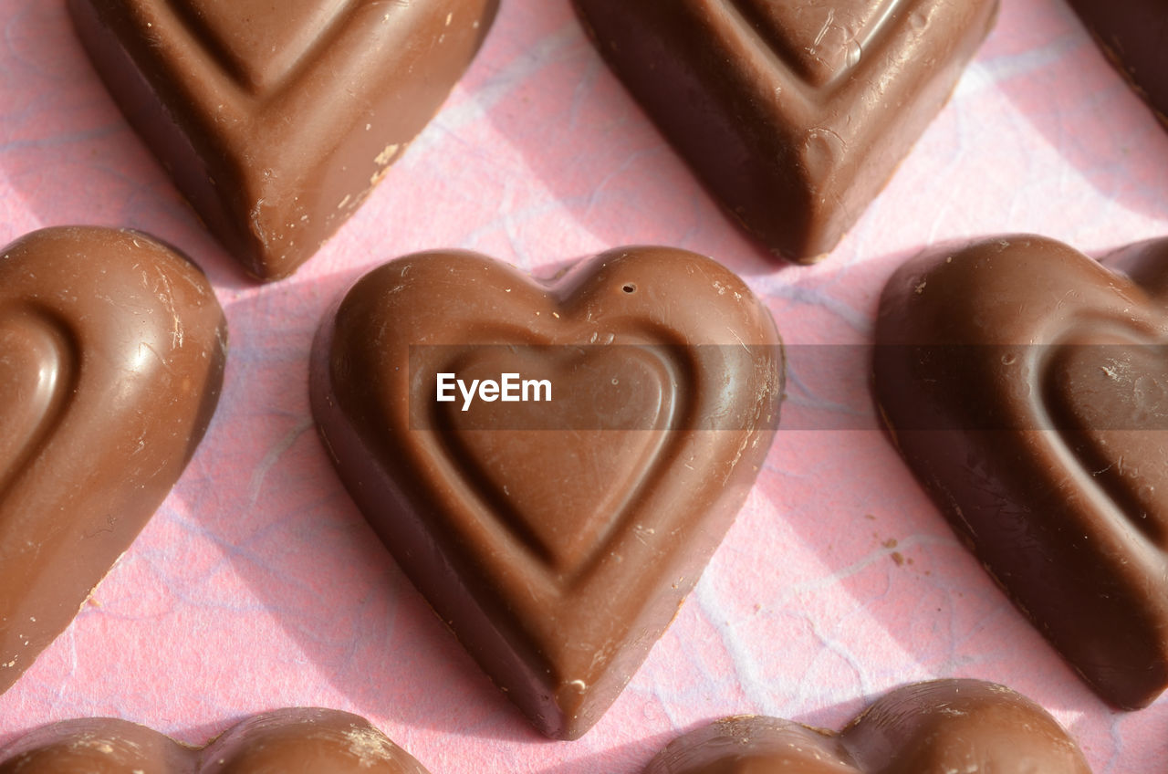 heart shape, food and drink, food, love, positive emotion, sweet food, indulgence, emotion, indoors, close-up, still life, baked, no people, sweet, cookie, design, temptation, freshness, high angle view, shape, valentine's day - holiday, snack, candy heart