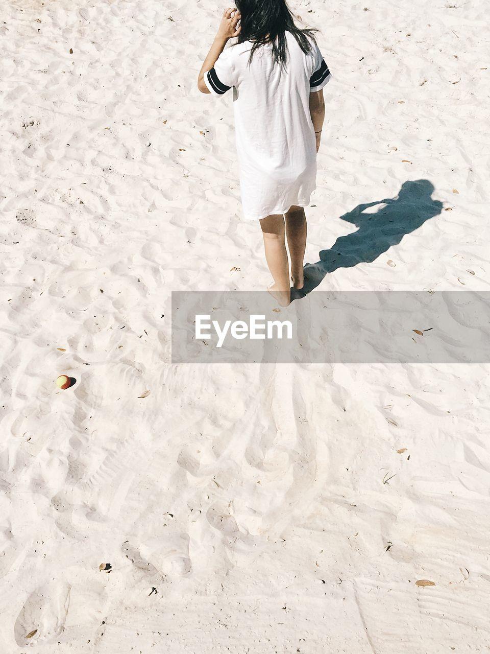 High Angle View Of Woman Walking At Beach