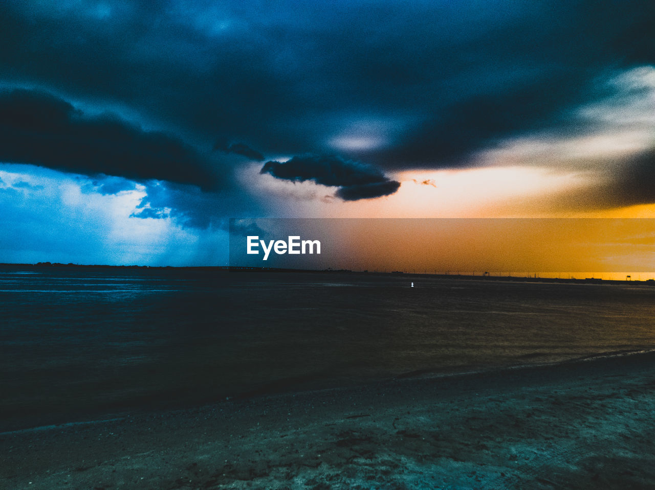 sunset, cloud - sky, nature, sky, beauty in nature, scenics, tranquil scene, sea, dramatic sky, tranquility, water, outdoors, no people, beach, storm cloud, horizon over water, travel destinations, landscape, day