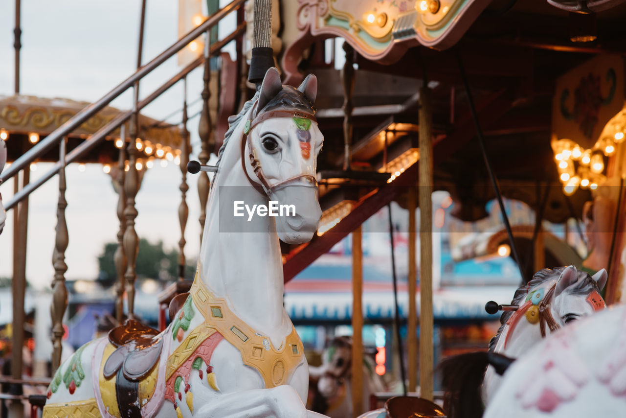 Close-up of carousel during sunset