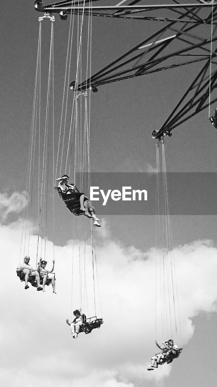 Low Angle View Of Swing Ride Against The Sky