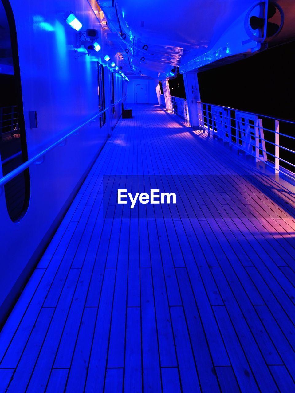 Illuminated Deck On Cruise Ship At Night