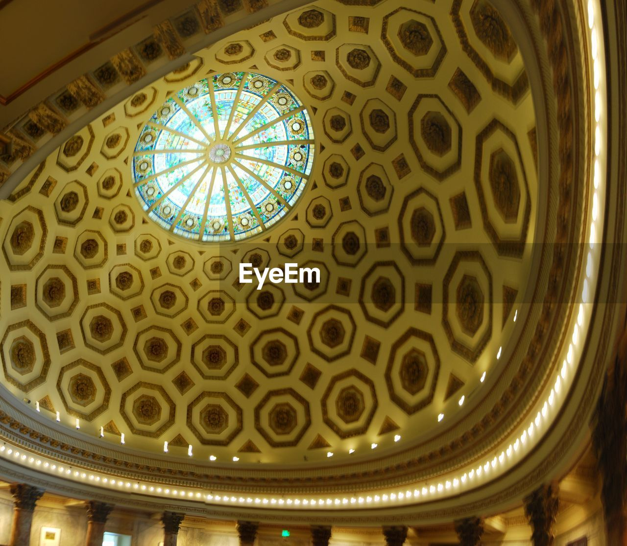 indoors, low angle view, ceiling, architecture, pattern, built structure, architectural feature, no people, architecture and art, architectural design, cupola, place of worship, illuminated, close-up, day