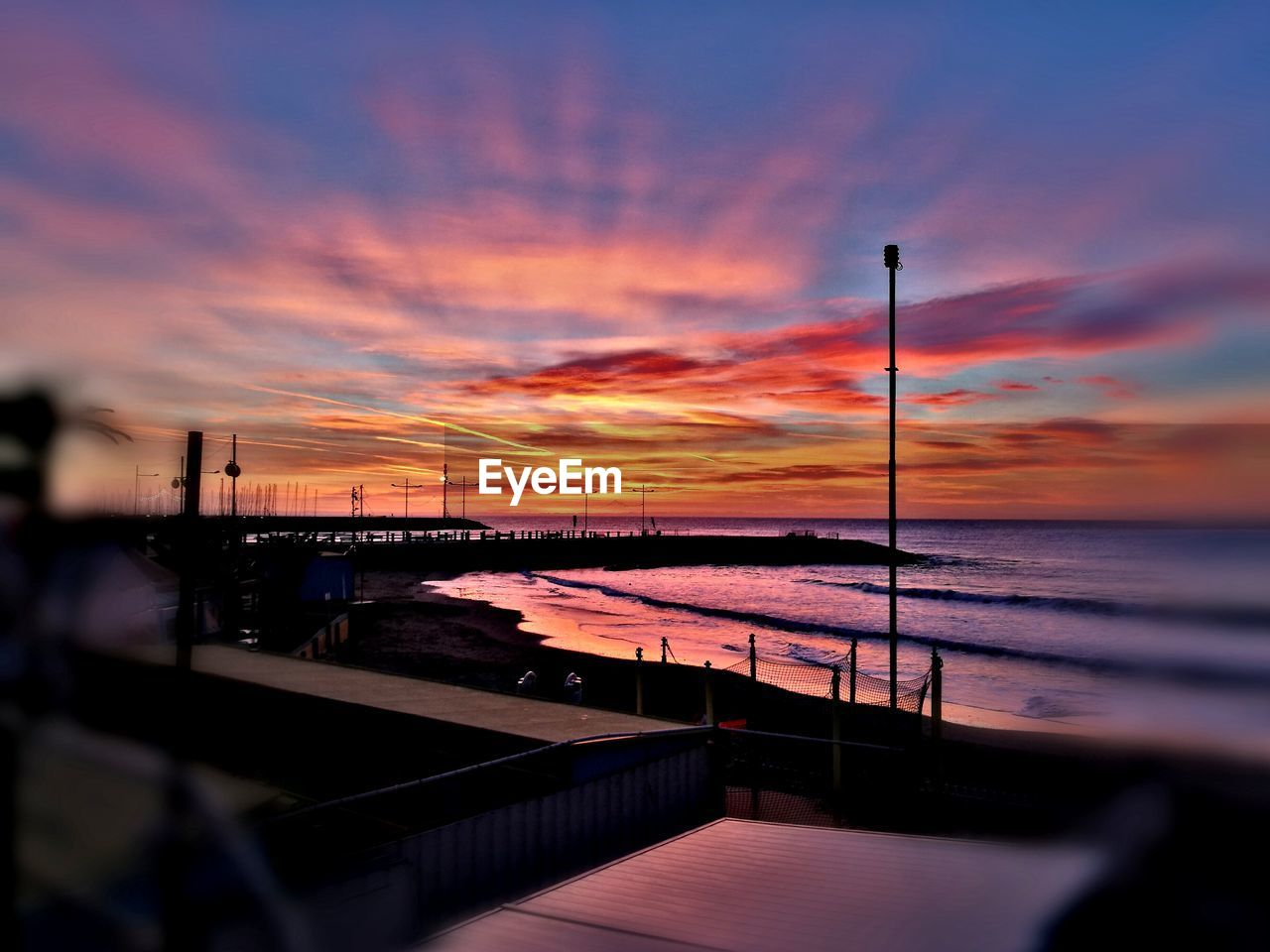 sunset, sky, cloud - sky, water, scenics - nature, beauty in nature, nature, sea, orange color, tranquility, no people, tranquil scene, dramatic sky, idyllic, outdoors, connection, railing, street light, street