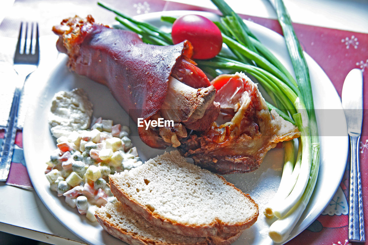 High Angle View Of Breakfast Served In Plate On Table